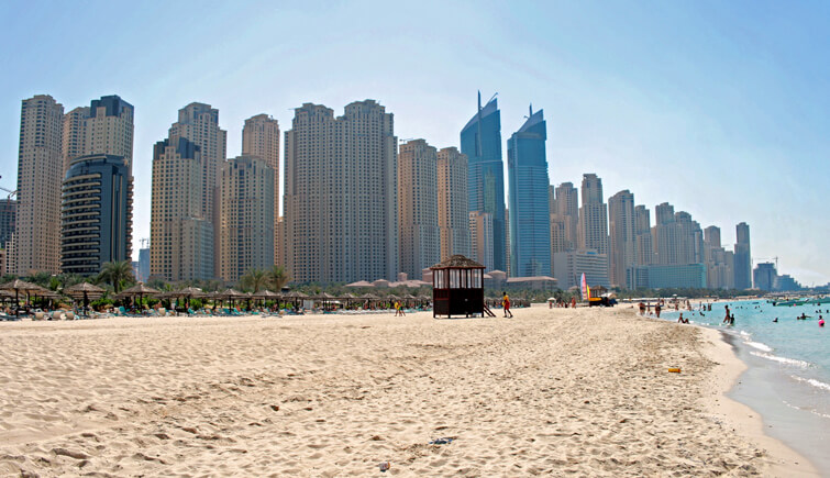 Walk across the sandy shore of Jumeirah Beach