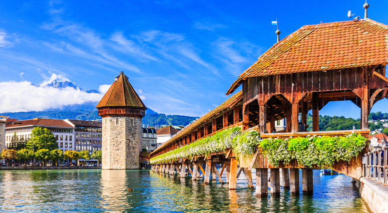 Lucerne, Switzerland. Historic city center with its famous Chapel Bridge and Mt. Pilatus on the background